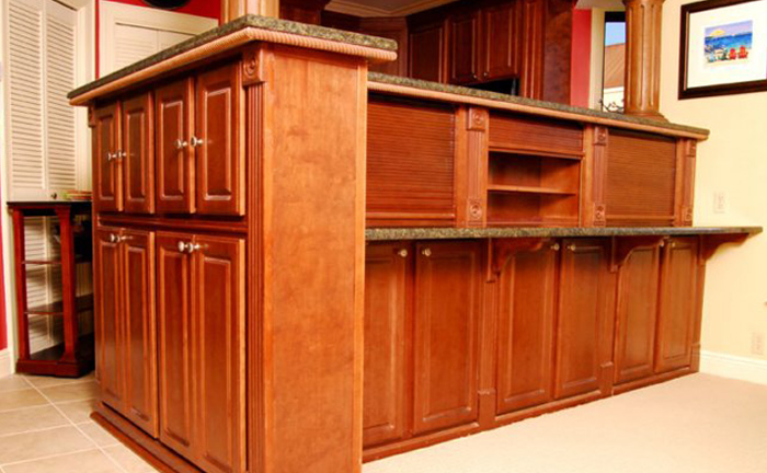 """Maynard Woodworking's team transformed our kitchen cabinets into an elegant yet comfortable kitchen. Even the smallest details within the kitchen cabinets recieved the same quality care and creativity."""